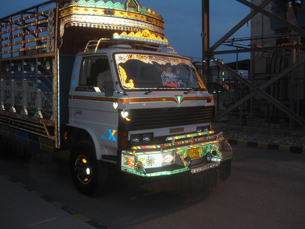 Local truck drivers in Pakistan take great pride in their vehicles as shown by the elaborate paint schemes here.